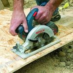 Man using a Bosh cordless circular saw