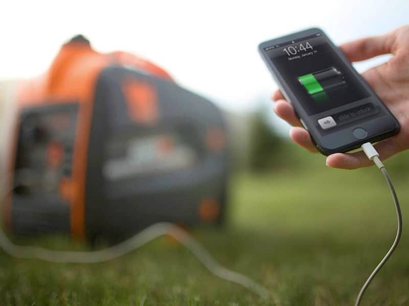 someone charging phone uding a portable generator