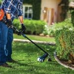 man using a gas string trimmer