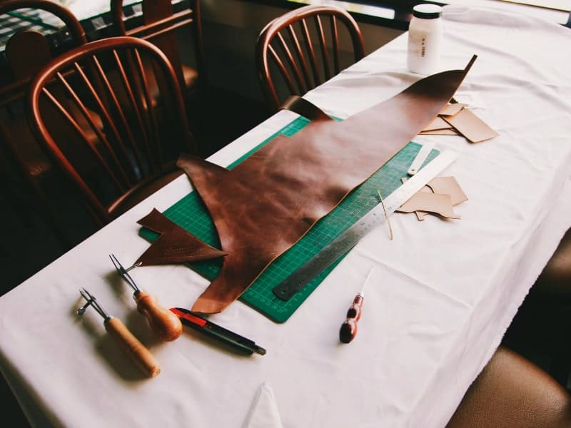 Pieces of green and brown leather
