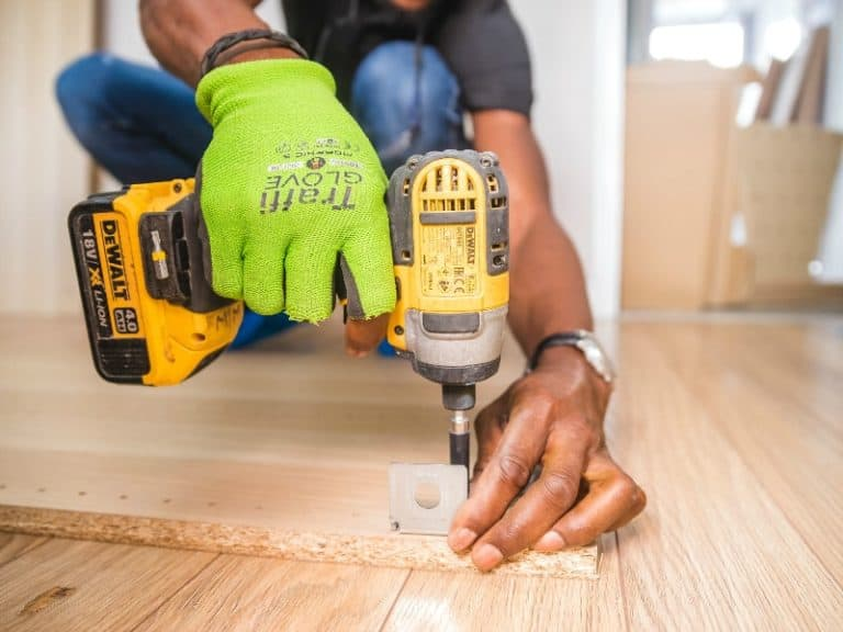 man working with a cordless drill