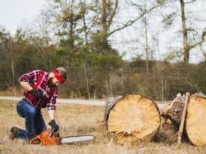 man-cutting-trees-using-chainsaw